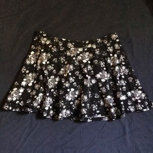 Dresses & Skirts - Black skirt with white and grey flowers.